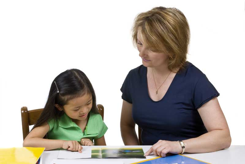 Reading Recovery teacher and student