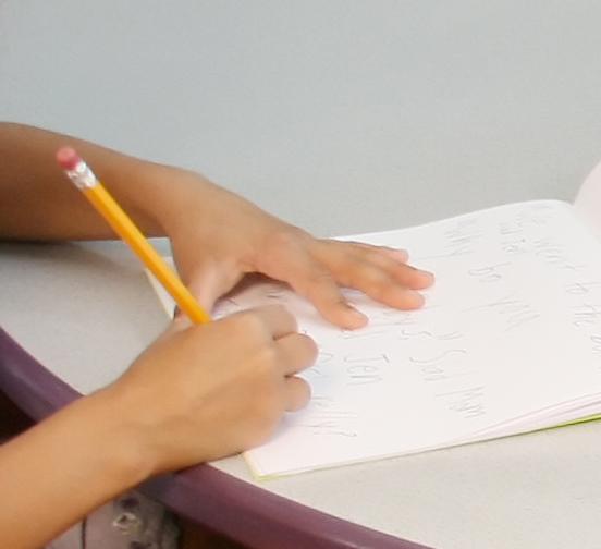 Child writing - Pioneer Valley Books